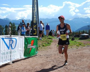 A runner crosses the finish line at Vail