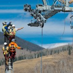 Vail Gondola workers reach for wires