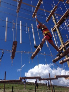 Benjamin on level one of the Ropes Course.