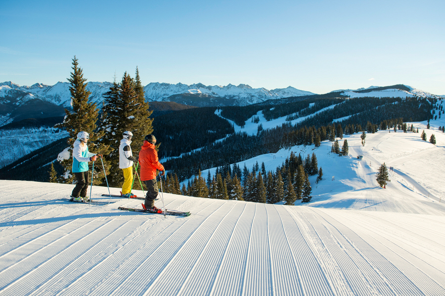 Group skiing groomed terrain in Vail, Colorado.